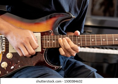 A man playing  electric guitar,Techniques for playing Bending and Vibrato