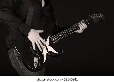 Man playing an electrical guitar