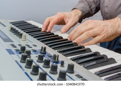 man playing electronic keyboard synthesizer
