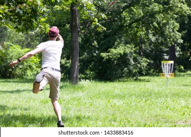 Man playing flying disc sport game in the park