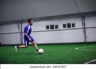 man playing football indoor