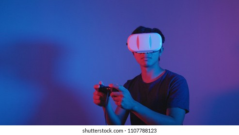 Man playing game with VR device