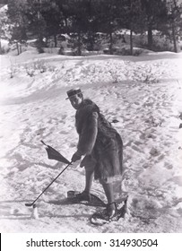 Man playing golf in the snow