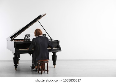 Man playing grand piano at the concert