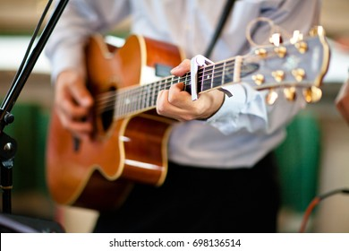 man playing guitar closeup