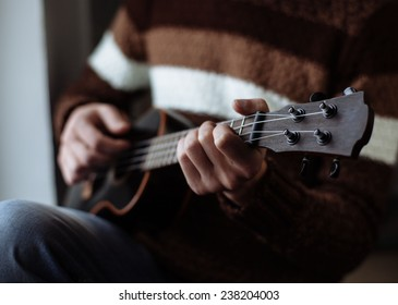Man playing guitar, Close-up shot.