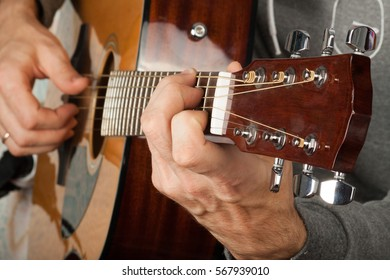 Man playing in guitar. Education. Music background.