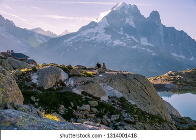 Man Playing Guitar in front of Iconic Mount-Blanc Mountain Range on a Bright Morning