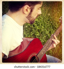 Man playing guitar, instagram style