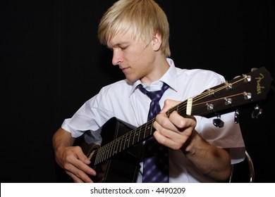man playing a guitar isolated on black background