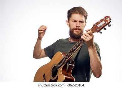 Man playing the guitar on a light background