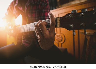 Man playing guitar on the style own.