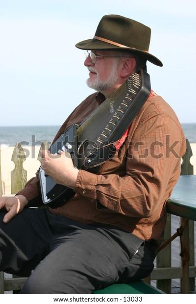 man playing harpsicord