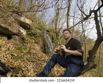 man is playing an Irish penny whistle Dniester. Ternopil region of western Ukraine