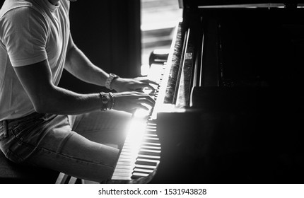 A Man playing music on a piano
