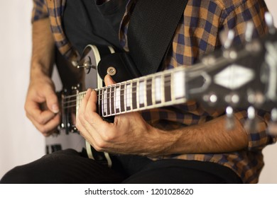 man playing on electric guitar, music concept