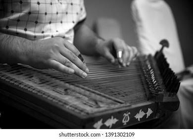 man playing on Qanun instrument (Santur)
