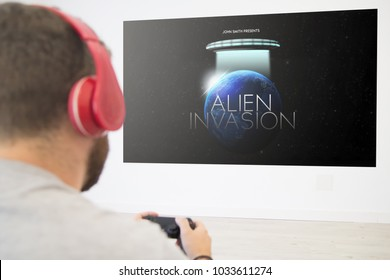 man playing online space game