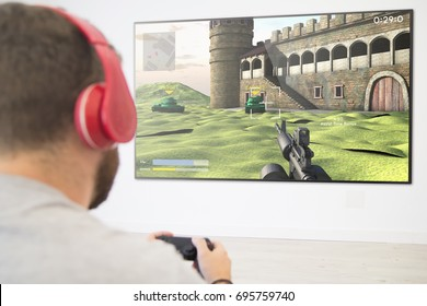 man playing online war game