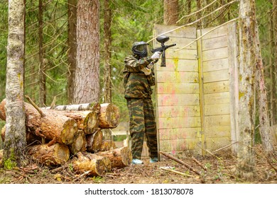 Man playing paintball outdoors in summer