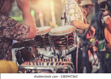man playing percussion musical instrument