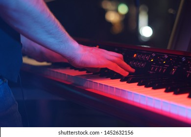 man playing the piano at a concert