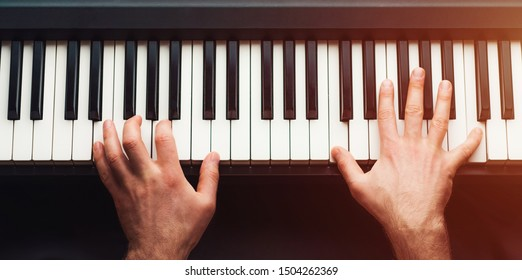 Man playing piano, top view