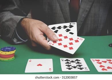 Man playing poker. Old style photo