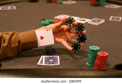 Man playing poker and performing a chip trick with ace up sleeve