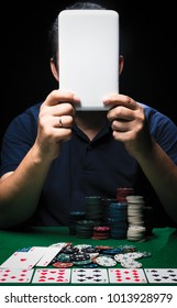 Man is playing poker with tablet online. Emotional  card player win in game, man very happy with making right choices, winning all the chips on bank. Concept of victory and internet online game