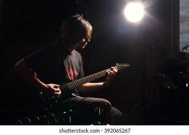 man playing rock music by electric guitar