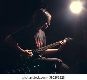 Man playing rock musik on bass guitar