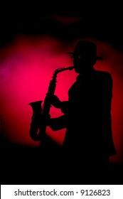 the man playing sax