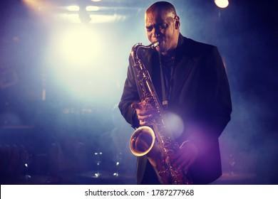 Man Playing Saxophone on Stage