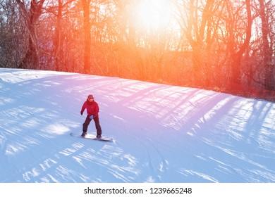Man playing snowboard on trail in ski resort with white snow background in Karuizawa ,Japan in Asia