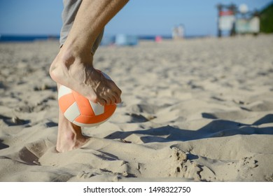 man playing soccer on beach with dribble skill and ball on vacation