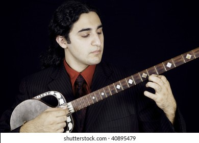 man playing traditional eastern string instrument