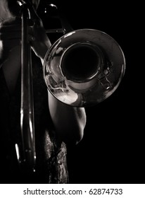 man playing a trombone, strong contrasting side-light, monochrome version