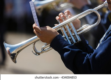 The man playing the trumpet in a military band