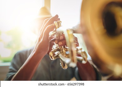 Man playing Trumpet, Saxophonist with Jazz Music instrument