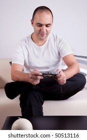 man playing video games on the couch