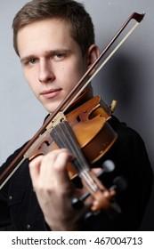 man playing violin close-up