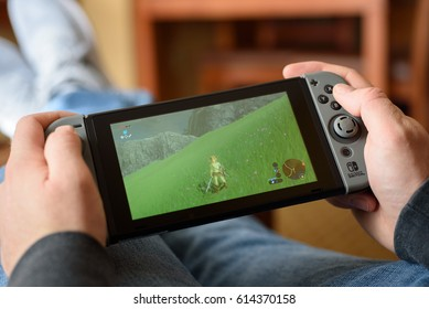 A man playing Zelda Breath of the Wild on a Nintendo Switch console in Fogelsville, Pennsylvania, USA on March 19, 2017.