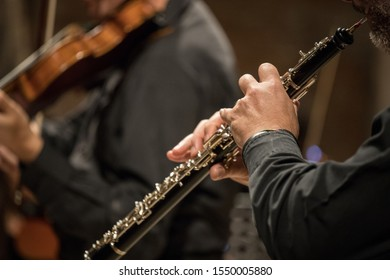man playng oboe during a classical concert