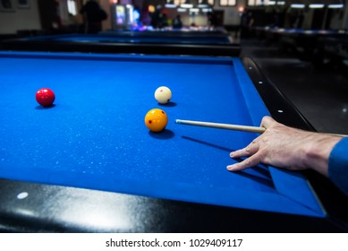 A man plays Carom Billiards.