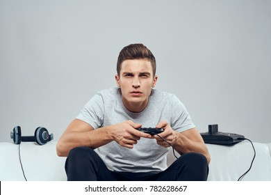 man plays the console, playstation