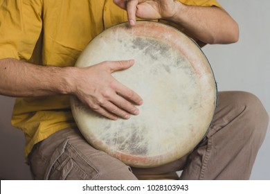 Man plays ethnic drum darbuka percussion close up musician. Male hands tapping djembe bongo hands movement rhythm. Musical handmade instruments world culture sound