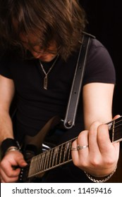 The man plays on an electroguitar