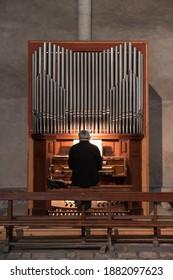 A man plays the organ in a church - Shutterstock ID 1882097623
