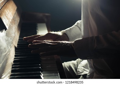 man plays a piano